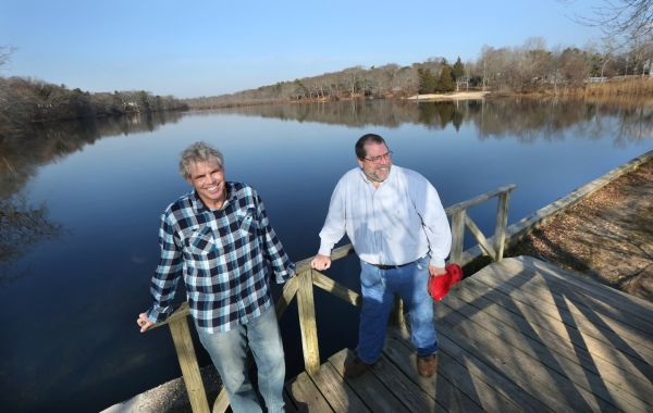 Environmentalists Kevin McAllister, left, and Doug Swesty, at Upper Lake in Yaphank on Thursday, Dec. 10, 2015, say that after monitoring the Carmans River, they found water temperatures rising. (Credit: Newsday / John Paraskevas)